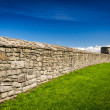 Medieval wall surrounding the castle with stone — Stock Photo