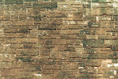 Old brown wall made from stone — Stock Photo