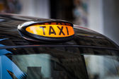 Taxi sign in UK — Stock Photo