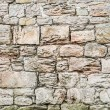 Medieval wall made ​​of large old stones — Stock Photo