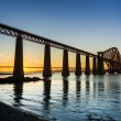 Stock Photo: Sunset between two bridges in Queensferry