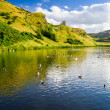 View of the mountains reflected in a lake in summer — Stock Photo