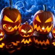 Group halloween pumpkins on the background smoke -  