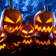 Smoking group Halloween pumpkins on marble table - Stock fotografie