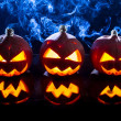 Smoking pumpkins for Halloween holiday - Стоковая фотография