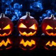 Three small smoking pumpkins for Halloween - 图库照片