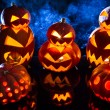 Stock Photo: Groups of strange pumpkins for Halloween
