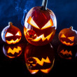 Pumpkins, smoke and black background for halloween holiday - Photo