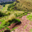 View to the City from stone footpath in mountains — Stock Photo