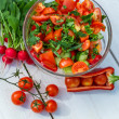 Stock Photo: Fresh vegetables in sunny garden on old plank