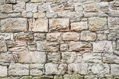 Medieval wall made of large old stones — Stock Photo