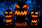 Three smoking pumpkins for Halloween celebration — Stock Photo