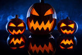 Three pumpkins for Halloween celebration — Stock Photo