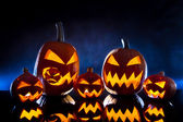 Group pumpkins for Halloween on a blue background — Stock Photo