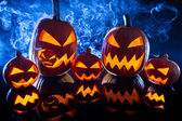 Smoking group Halloween pumpkins — Stock Photo