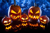 Smoking group Halloween pumpkins on marble table — Stock Photo