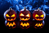 Smoking pumpkins for Halloween holiday — Stock Photo