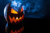 Smoke rising from the pumpkin for halloween — Stock Photo