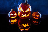 Pumpkins, smoke and black background for halloween holiday — Stock Photo