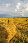 Windmill on the field with stubble — Stock Photo