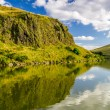 Summer view of the mountains reflected in a lake — Stock Photo
