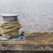 Stock Photo: Rope moored to pier