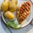Roasted chicken breast with potatoes and dill on plate — Stock Photo
