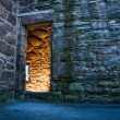 Royalty-Free Stock Photo: Lighted dorway to the medieval castle