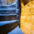Stock Photo: Stone Spiral Stairway with mixed light in Castle