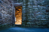 Lighted dorway to the medieval castle — Stock Photo