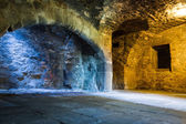 Warm and cold light in stone chamber — Stock Photo