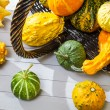 Stock Photo: Colorful pumpkins harvested in wicker basket
