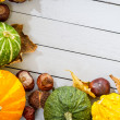 Stock Photo: Autumn frame made ​​of pumpkin, chestnuts and leaves on wood