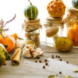 Stock Photo: Autumn vegetables on basement shelf on light background