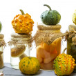 Stock Photo: Preserving small pumpkins and mushrooms in basement