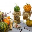 Stock Photo: Jar with mushrooms and pumpkin in basement on wooden shelf