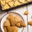 Homemade Christmas cookies before and after baking — Stock Photo #14612957