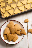 Homemade Christmas cookies before and after baking — Stock Photo