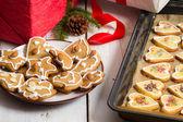 Closeup Christmas gifts and homemade cookies — Stock Photo