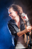 Laughing young singer on the stage — Stock Photo