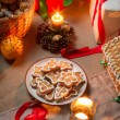 Decorated Christmas cookies and warm light of candles — Stock Photo