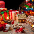 View of the Christmas table with presents and a Christmas tree — Stock Photo
