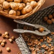Different kinds of nuts in wicker baskets - Stock Photo