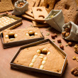 Preparations for combine elements of gingerbread cottage — Stock Photo #14878853