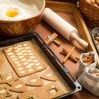 Prepare dough for gingerbread cookies on a baking tray - Stock Photo