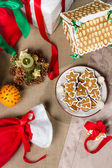 Close-up on Christmas gifts and goodies on the table — Stock Photo