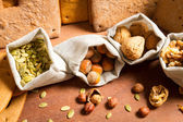 Close-up on different kinds of nuts on the background baked ging — Stock Photo