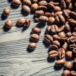 Royalty-Free Stock Photo: Coffee seed on wooden table background no. 2