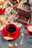 Freshly brewed coffee served with cookie — Stock Photo