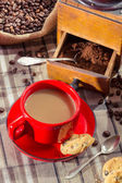Freshly brewed coffee served with a biscuit for breakfast — Stock Photo